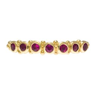 Stunning ruby set eternity band featuring 7x 2mm rubies with tiny bobble details on 2mm fine hammered band by Sophie Harley London.