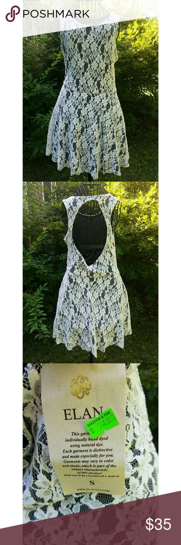 NWT Elan White Lace Black Lining Sleeveless Dress Sexy meets innocent in this new with tags NWT Elan White Lace Black Lining Sleeveless Dress  Womens Small Retail price $75  Made in USA  Exposed Back  White lace shell with black rayon full lining  Slips over head with exposed back Elan Dresses Mini