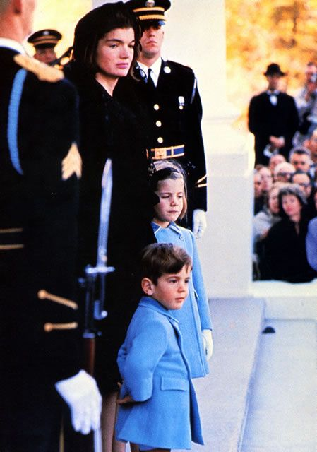 Sunday, November 24, 1963, a very sad day for this young family as they wait for the funeral procession to the Capitol.