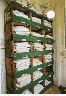 french linen shirts in old wooden display cabinet