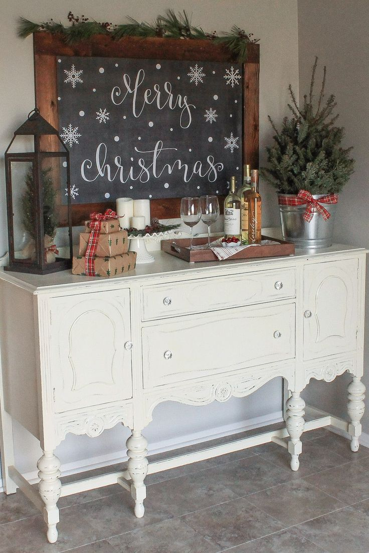 Create a cozy Christmas kitchen wine nook with some simple rustic decor! Christmas buffet decor. Christmas dining room decor. Christmas hutch decor.