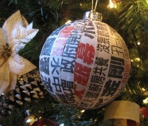 Chinese Newspaper Ornaments: Recycled ornaments were wrapped and decoupaged with actual headlines from Chinese newspapers.