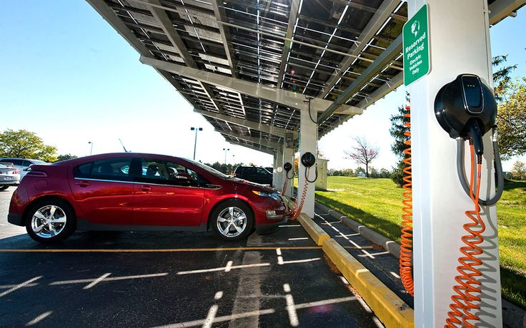 A Chevrolet Volt electric vehicle with extended range charges in one of the 10 solar-powered charging stations installed at the Detroit-Hamtramck Assembly Center in Detroit. Description from media.gm.com. I searched for this on bing.com/images