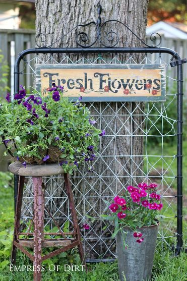 Garden art and annuals plus an old gate