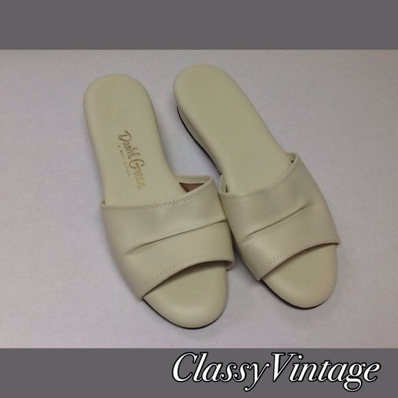 Vintage Daniel Green slippers . Off white vintage slippers. All man made components. Size 8 - 10 inches long and 3 1/2 and widest. No obvious flaws and never worn Daniel Green Shoes Slippers
