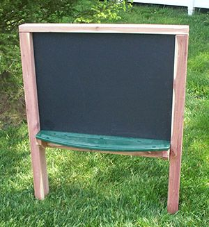 The outdoor Chalk Board provides a drawing and writing surface for two children. Children can practice literacy skills as they write a menu for the outdoor kitchen, math skills as they draw shapes, science skills as they draw plants or record the weather, and fine motor skills as they add small details to their drawings. This outdoor learning equipment is made of slate - a durable surface perfect for the natural playground.