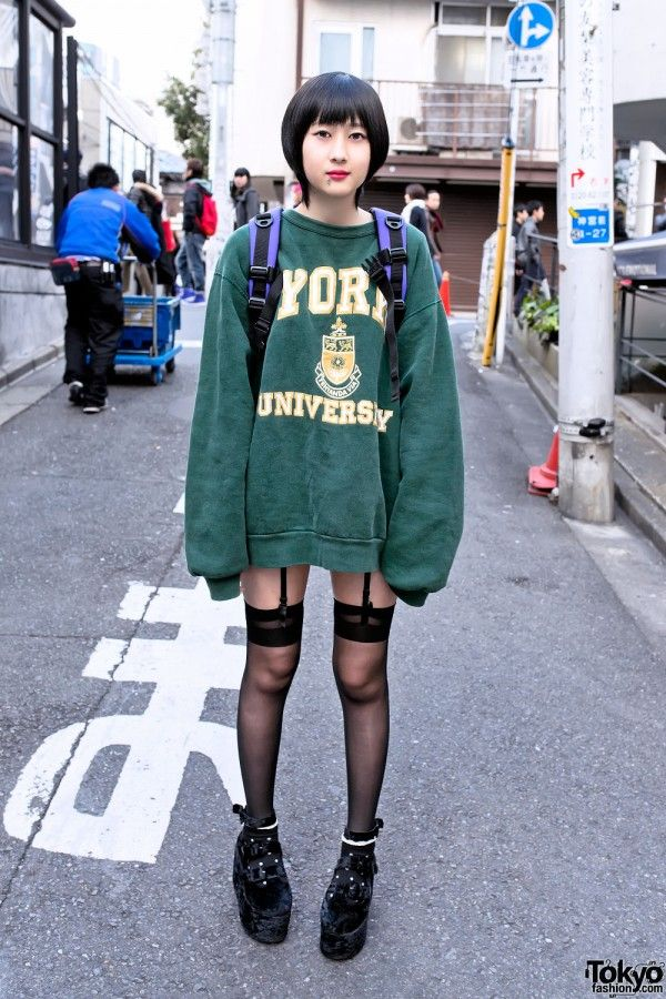 Akane is a friendly 17-year-old student who met in Harajuku. You might remember her from our street snap last spring. Akane is wearing an oversized sweatshirt from the Tokyo new/resale shop Sevens with garter stockings, lace-decotated socks, and black velvet platforms with buckles. Her large backpack is by Hollykate, she has a facial piercing, and she also told us that she's wearing Marie Claire accessories. (Tokyo Fashion, 2014)