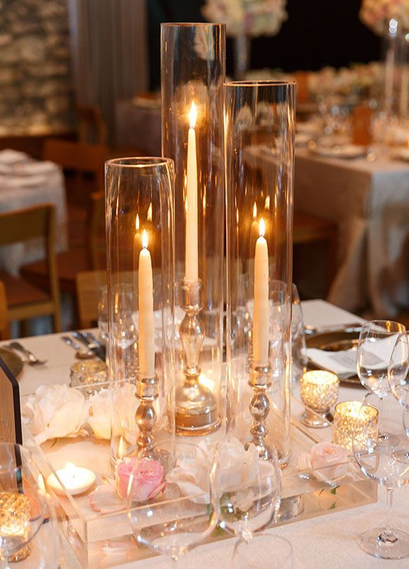 Elegant candle centerpiece on wedding reception table