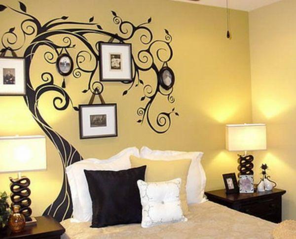 wandtatoo-schlafzimmer-baum-bilder- viele dekokissen