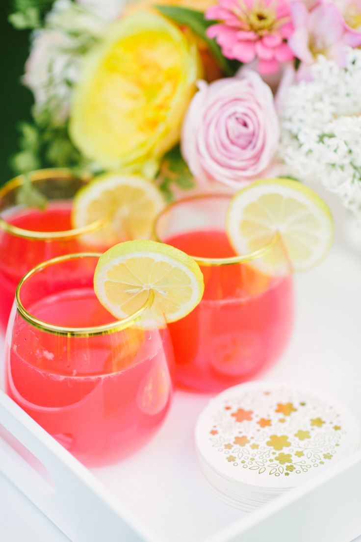 Pretty punch in gold rimmed glasses. Photography: Paper Antler - paperantler.com Read More: http://www.stylemepretty.com/2014/08/11/bright-love-in-bloom-wedding-inspiration/