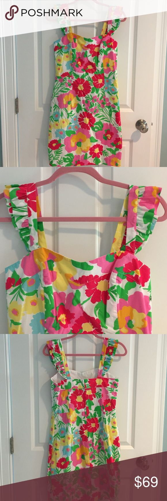 """Lilly Pulitzer Floral Dress, size 8 Lily Pulitzer floral dress, size 8. 100% cotton. Ruffle detailing on straps. NOTE: this has never been worn, but the straps were hand sewn down at one point. I have removed the stitching and the marks will be unnoticeable after a good iron. The asking price reflects this.  No trades, all offers will be negotiated when using the """"offer"""" button. Please read my reviews and buy with confidence! Lilly Pulitzer Dresses"""