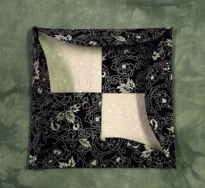 A number of years ago, I saw a finished quilt that was a two sided beauty...it appeared to be done using a modified version of a Cathedral W...