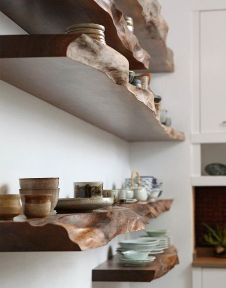 Half-sawn walnut planks are left in their natural state and treated with a high gloss sealer to provide stylish shelving. Do a Google search for timber merchants that supply rough cut hardwood
