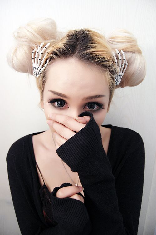 Those skeletal hand hair accessories are so cute with her buns.