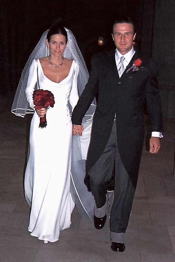 Both Courteney Cox & David Arquette wore Valentino and were all smiles on their day, but they had hired 50's comedic husband & wife team Lucille Ball and Desi Arnaz to entertain guests over lobster and steak.  That cannot be right.  They have since divorced.