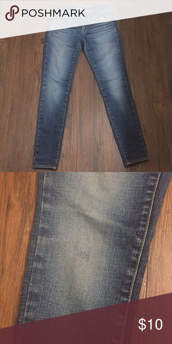 1 HOUR ONLY! American Eagle Jeggings Mid rise 2 short. Small hole at knee. Pictures make them look really light (LED lighting), but they're a lot more blue in person. American Eagle Outfitters Jeans