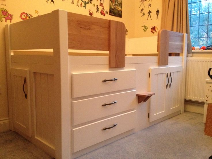 3 Drawer childrens cabin bed in white with solid oak front rails, steps and knobs. This childrens cabin bed is slightly different with the additional door on the end for easier access to storage space behind the drawers. All our furniture is guaranteed for 20 years, we only use the best natural and solid woods. You can design your own cabin bed at www.aspennfurniture.co.uk and we will email back a quote within a day. Contact us on 01937 843386 / ianaspenn@btinternet.com