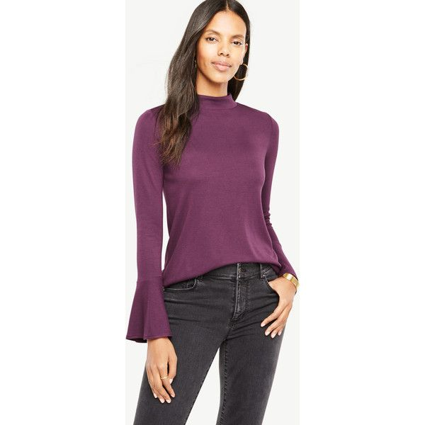 Ann Taylor Mock Neck Flare Cuff Top ($50) ❤ liked on Polyvore featuring tops, plum petal, long length tops, back slit top, purple long sleeve top, plum top and mock neck top