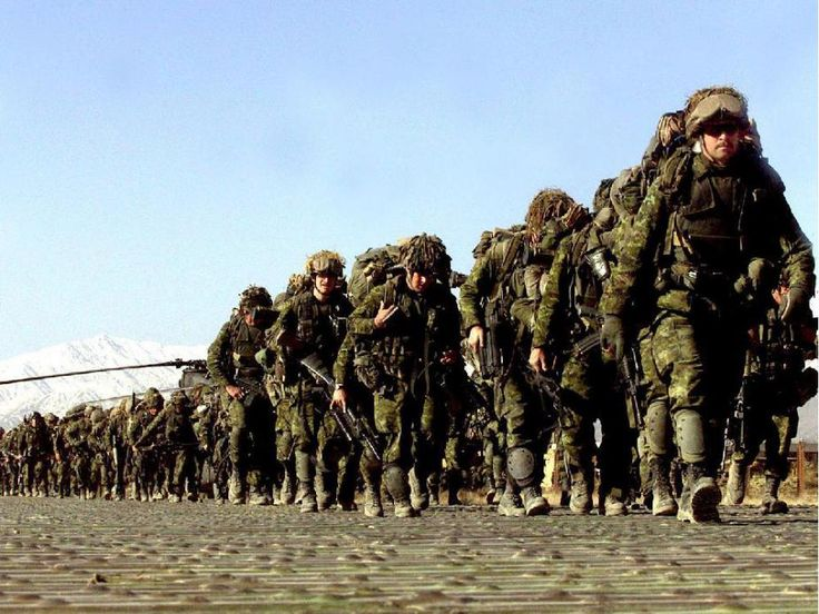 Bagram, Afghanistan. 14 March 2002 - Heavily laden with their full kit, members of the 3rd Battalion, Princess Patrica's Canadian Light Infantry (3 PPCLI) Battle Group march to the Chinook helicopters waiting to transport them into the mountains near Gardez in eastern Afghanistan for Operation ANACONDA, the Canadian Army's first combat mission since the Korean War. Cpl Lou Penney / Canadian Armed Forces