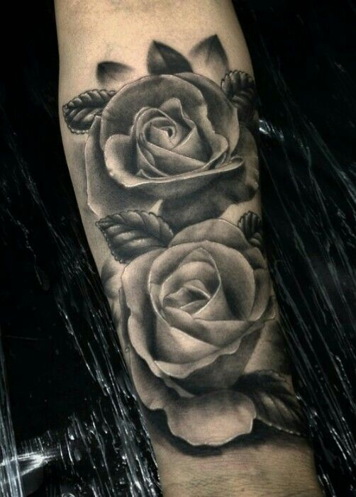 Black and gray roses tattoo