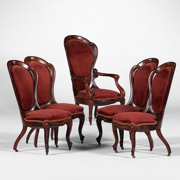 John H. Belter Arm Chair And Four Side Chairs Each With Serpentine Carved Backs Resting On Cabriole Serpent Legs With Casters - American   c. 19th Century  -  Liveauctioneers