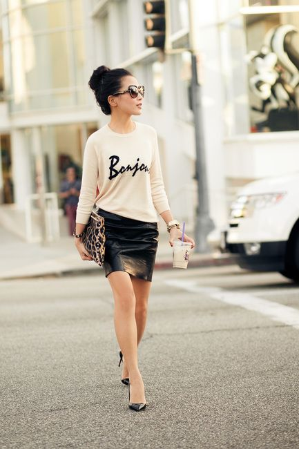 Knit sweater and leather skirt