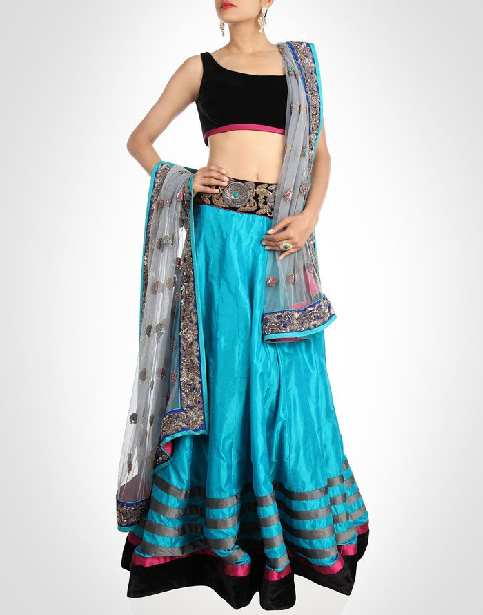 This blue silk lehenga has an everlasting grace, teamed with black velvet blouse.SHOP NOW@ www.kimaya.in