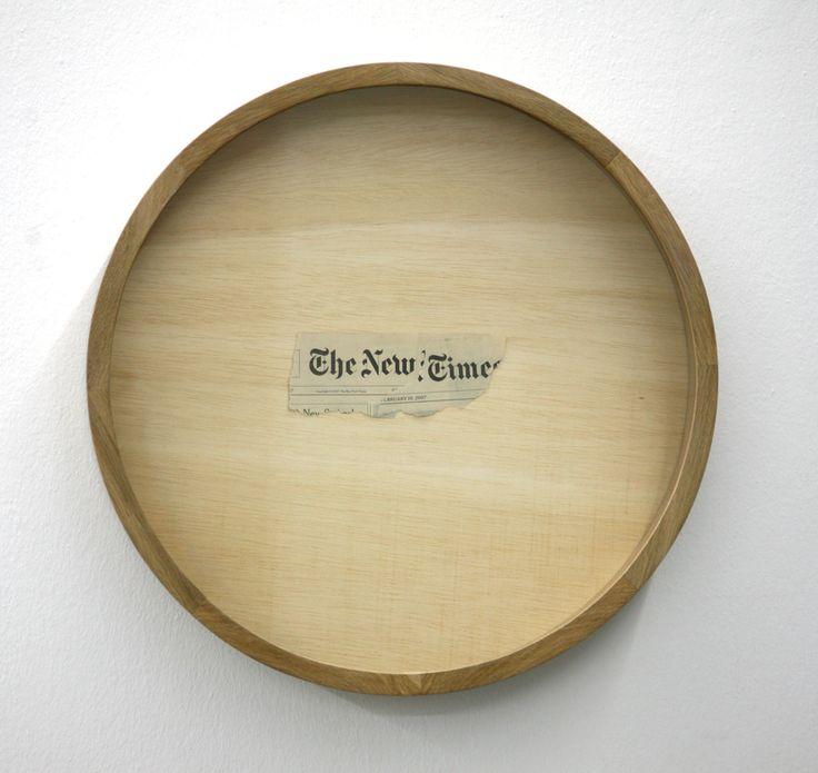 Mircea Cantor - No title, 2009  Torn newspaper, glass and wood diameter  49 cm depth 7 cm
