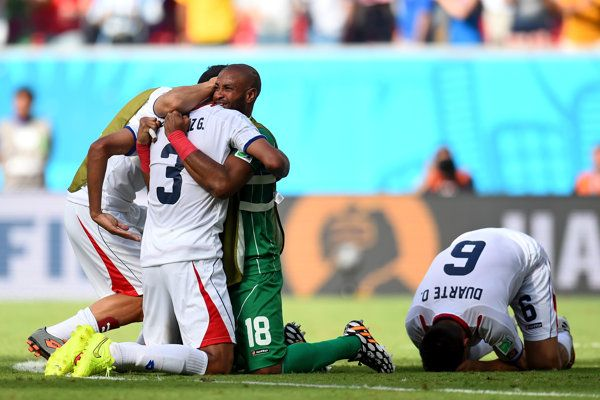 Giancarlo Gonzalez of Costa Rica celebrates with teammates after defeating Costa Rica 1-0 during the 2014 FIFA World Cup Brazil Group D matc...