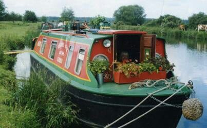 more traditional boat transformed into a houseboat