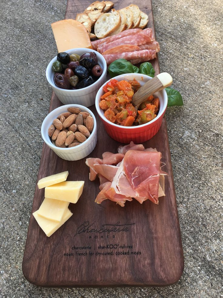 "Gorgeous walnut Charcuterie Board, 36"" long. ""Charcuterie Board"", the pronunciation and definition are all laser-engraved into the surface. Available soon at MatsonWoodworking.com."