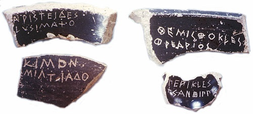 Ostraka, or pieces of broken pottery with names carved onto them. Ostracism was an important feature of Athenian democracy. Once a year, a vote would be taken to determine if anyone should be sent into a 10 year exile-- this would often be abused by different factions to kick their political opponents out of Athens. Themistocles, the Athenian general who was the hero of the Battle of Salamis, was one of many Athenian leaders ostracized; his name is on the top right shard. Pericles' is below.