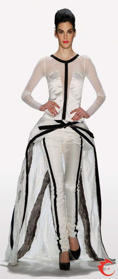 anja gockel sophisticated white wedding gown with transparent fabrics, lace and black striped details