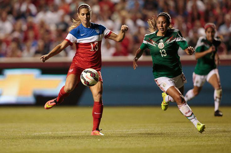 Alex Morgan and Bianca Sierra of Mexico, Sept. 13, 2014, Sandy, Utah. (U.S. Soccer)