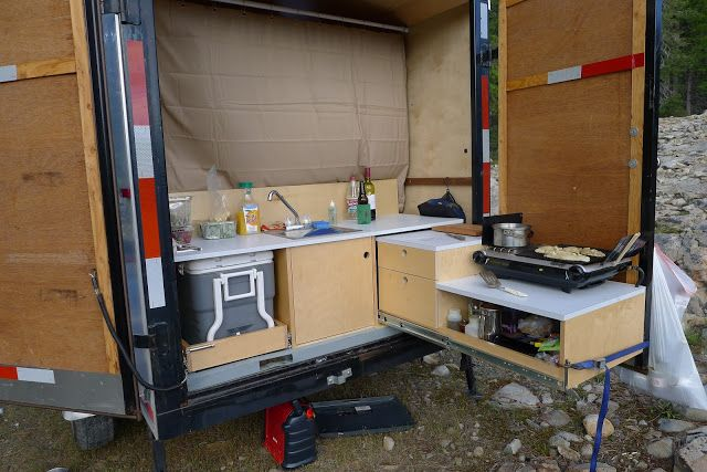 Enclosed cargo trailer camper conversion email this for Trailer kitchen ideas