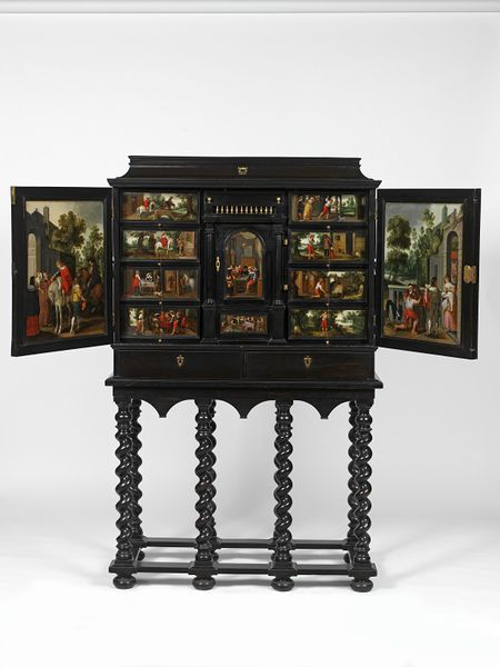 Cabinet Place of origin:Antwerp, Belgium (probably, made) Bruges, Belgium (restored) Date:1640-1660 (made) 1836 (restored) 1850-1900 (made) Artist/Maker:Unknown (production) Materials and Techniques:Oak carvase veneered in ebony and ebonised wood, set with oil-painted panels; the interior perspective with mirror glass, silvered wood, and veneered with ivory, ebony, turtleshell and snakewood