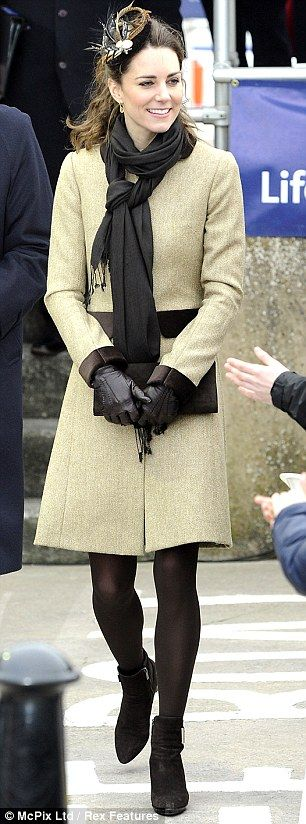 Kate Middleton in Katherine Hooker tweed coat, Vivien Sheriff fascinator, Russell & Bromley ankle boots, - lifeboat launch in Anglesey, February 2011.