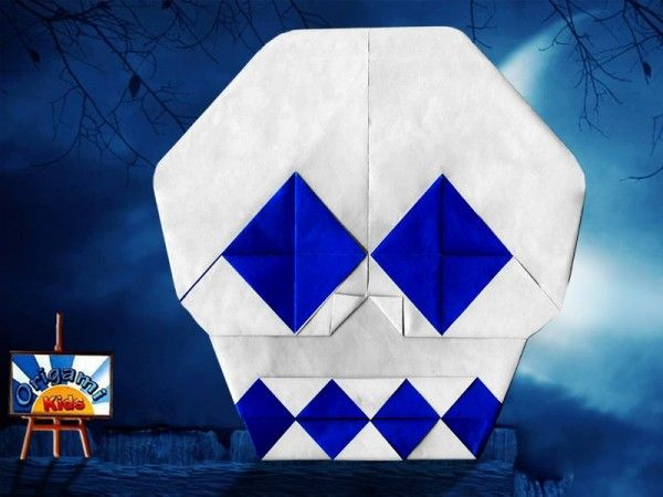 Origami Skull by Yoshihide Momotani  Designer: Yoshihide Momotani  Folder and Photo: @Origami_kids  Halloweenn is almost here, so why not fold these Origami Skull mask to decorate your home?. Do It yourself whith your kids.  Difficulty level: Easy Time to fold 20 min. 12 steps. Folded from a one classic Blue and White Single Uncut square origami paper, about 30cm x 30 cm.  How to fold: http://origami-blog.origami-kids.com/origami-skull-by-yoshihide-momotani.htm