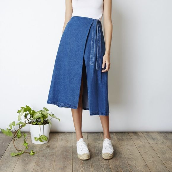 Denim wrap skirt BRAND NEW! MIDI wrap skirt that ties up at the waist with an open split in a classic blue denim fabric. The fifth Skirts