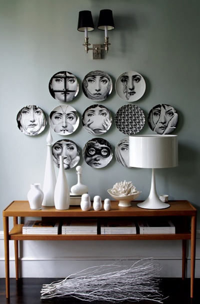 perfect arrangement with fornasetti plates @ maya frank