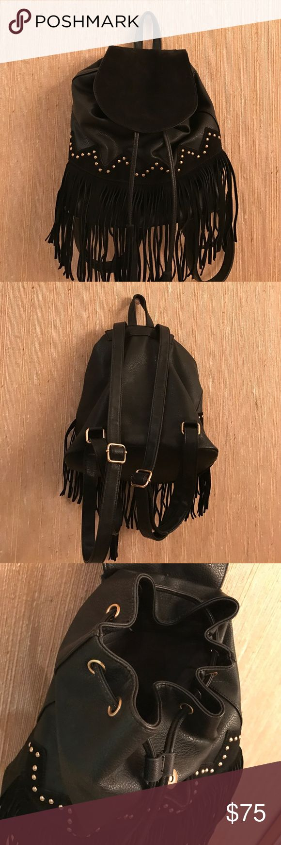 Black Leather and Gold Studded Fringe Backpack Only worn once! Just like new! Adorable durable leather backpack that is perfect for festival season, cinched closure with lots of pockets for storage. Textured flap and fringe, with studded bottom and adjustable straps. Approximately 12 inches tall. Bags Backpacks