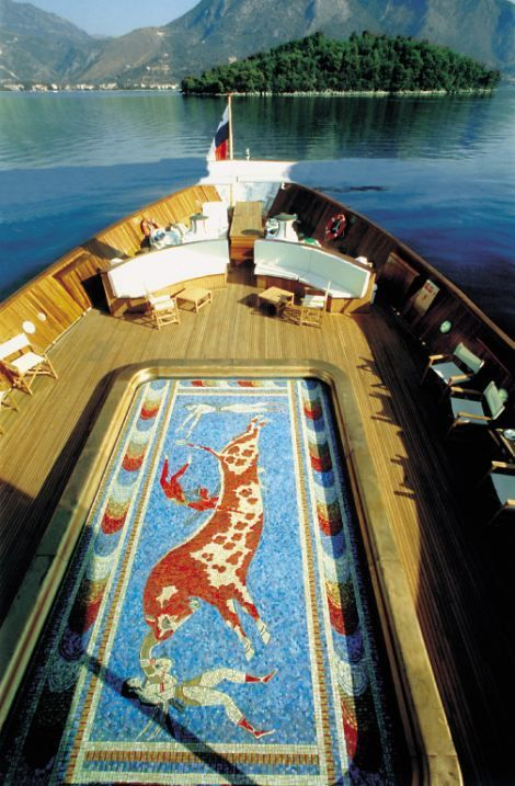"The yacht 'Christina' formerly owned by the tycoon Aristotle Onassis.  - the pool on deck has a mosaic bottom like the ancient Minoan ""Leaping of the Bull"" from the Knossos Palace!"
