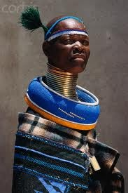 Ndebele Belle Neck Rings.  Both men and women wear them.  They are stiff in nature and have evolved from the torc, worn by ancient Celts and those in the European Iron Age, where they were worn as a status of wealth.  The other type is more like a coil, that is worn by women.  In some African and Asian cultures, next rings are worn to strictly create an appearance that the neck has been stretched.