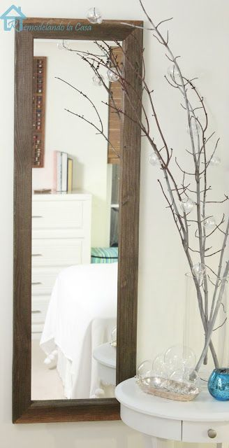 DIY - Reclaimed wood transforms one of those cheap mirrors.