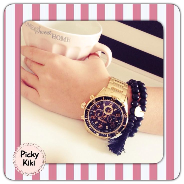 Fashionable set of handmade bracelets with black shiny and matte beads,decorative heart from ivory and a pompon   Fall-Winter Collection 2015-'16   Picky Kiki