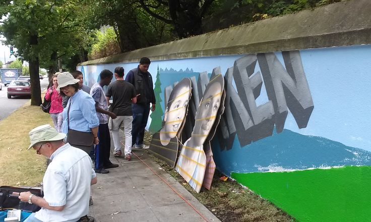 Adding three-dimensional elements to the mural.