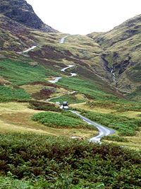 Hardknott Pass from Hardknott Castle (Roman Fort) - Hardknott Pass is a mountain pass in the heart of the Lake District, England.  It is a popular challenge for drivers as it is one of the steepest through roads in Britain, with a 30% (approx. 1:3) gradient and numerous hairpins