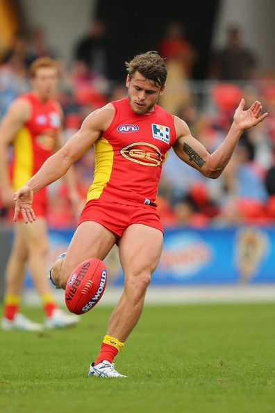 Maverick Weller of the Suns kicks the ball during the round 14 AFL match between the Gold Coast Suns and the Adelaide Crows at Metricon Stadium on June 29, 2013 in Gold Coast, Australia. http://footyboys.com