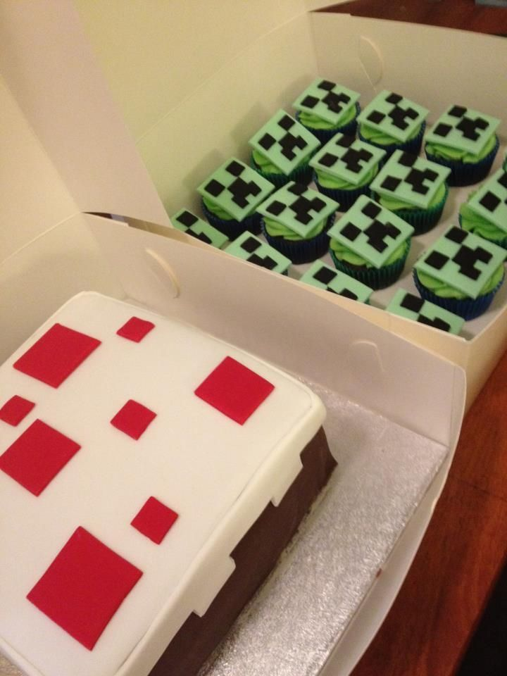 Minecraft 'cake' Cake with 'Creeper' face cupcakes - For an avid minecraft fan. The cake from Minecraft and some cupcakes with fondant 'Creeper' face toppers.