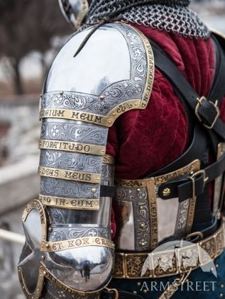Awesome! Latin carved into his armor. Can't read what it says, though, since there are parts of it I can't see.